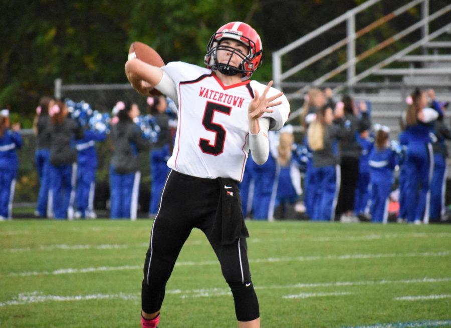 Junior+quarterback+Nick+McDermott+warms+up+before+Watertown%27s+game+at+Stoneham+on+Oct.+13%2C+2017.