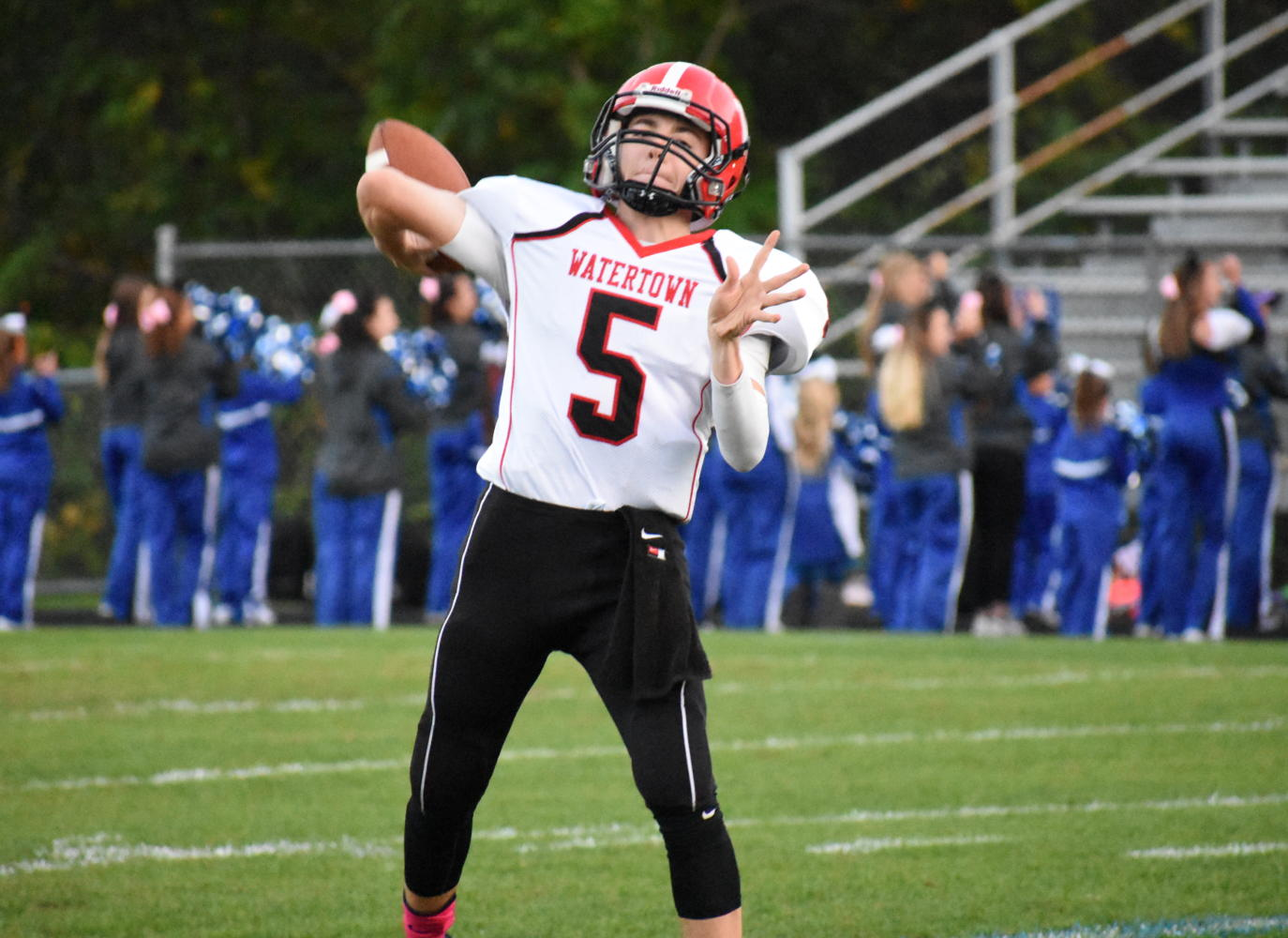 Junior quarterback Nick McDermott warms up before Watertown's game at Stoneham on Oct. 13, 2017.