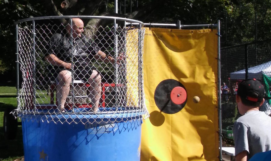 Officer Colon can only hope this ball misses its mark while working the dunk tank at Watertown's annual Faire on the Square on Saturday, Sept. 23, 2017.