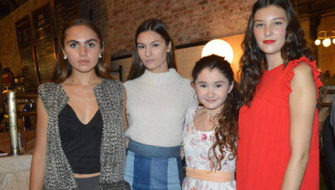 Teen fashion designer Ruby McAloon (second from right) poses at 17+, the opening night event for Boston Fashion Week held at Explorateur in Boston on Oct. 1, 2017.