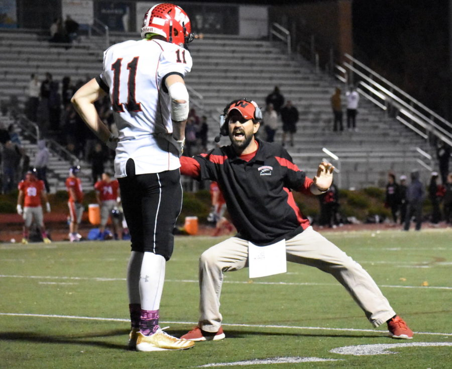John Korte (11) takes in the lesson of Watertown coach John Cacace after the Raiders tied the game with 12 seconds left. Watertown defeated Somerville, 21-20, on Friday, Nov. 3, 2017, at Dilboy Stadium to advance to the MIAA Division 5 North finals.