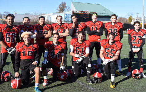 Members of the Watertown High football team pose on Victory Field after being Belmont, 35-16, in their annual football game on Thanksgiving morning Nov. 23, 2017.