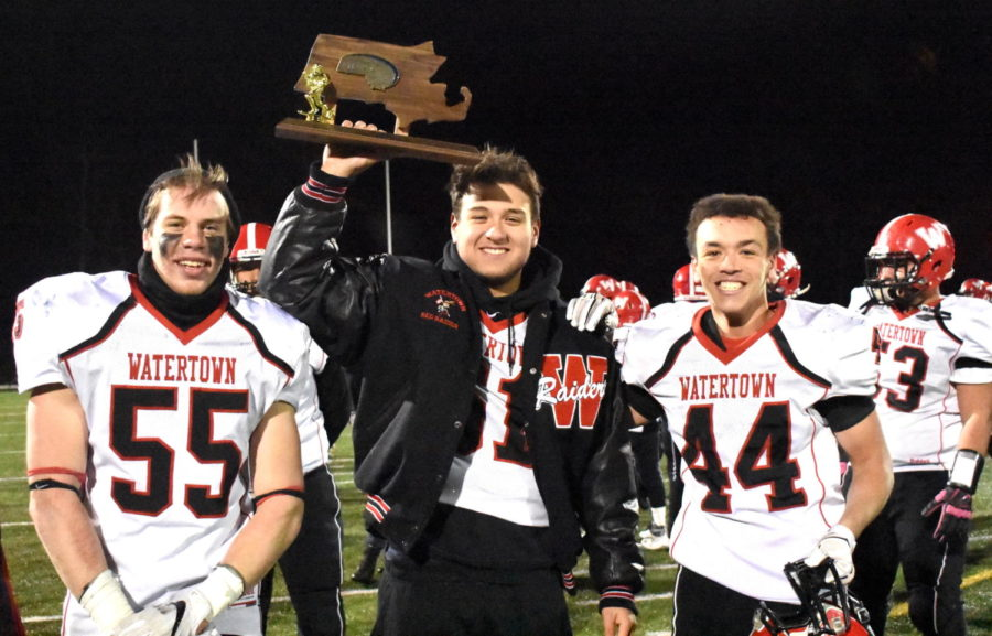 Watertown High football captains Bel Landry (left), Jake Motton (center), and Matt Muldrew celebrate after the Raiders beat Lynnfield, 38-34, for the Division 5 North championship on Friday, Nov. 10, 2017.