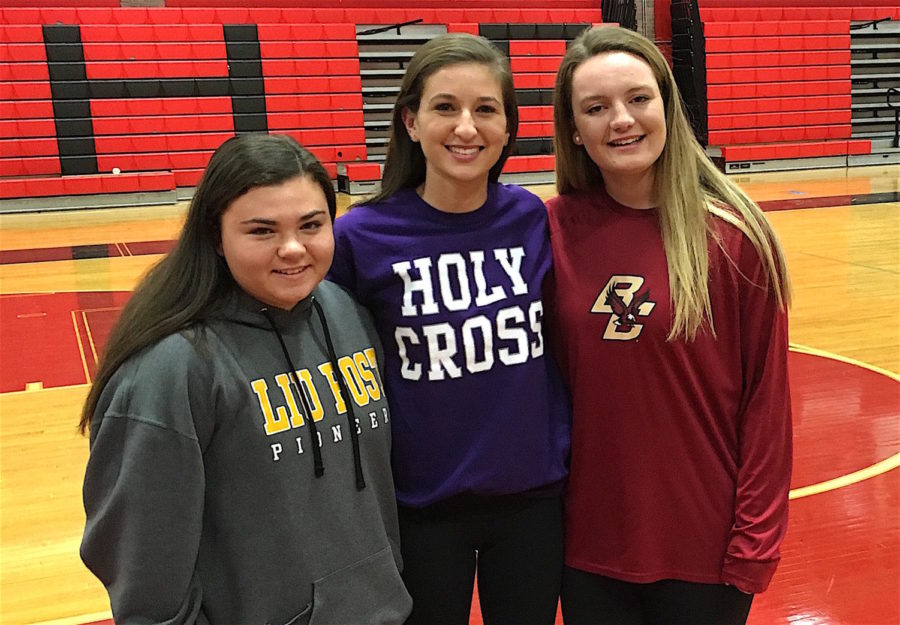 Maddie+Leitner+%28LIU+Post%29%2C+Emily+Koufos+%28Holy+Cross%29%2C+and+Jonna+Kennedy+%28Boston+College%29+pose+for+a+picture+at+their+Letter+of+Intent+signing+ceremony+Nov.+13%2C+2017%2C+in+the+Watertown+High+School+gym.