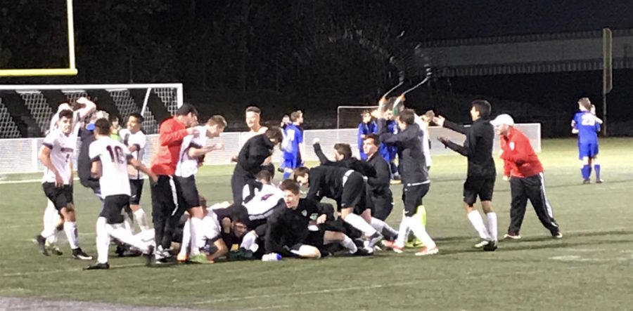 The+Watertown+High+boys%27+soccer+team+celebrates+its+3-2+overtime+victory+over+Bedford+in+the+MIAA+Division+3+North+quarterfinasl+on+Monday%2C+Nov.+6%2C+2017.+