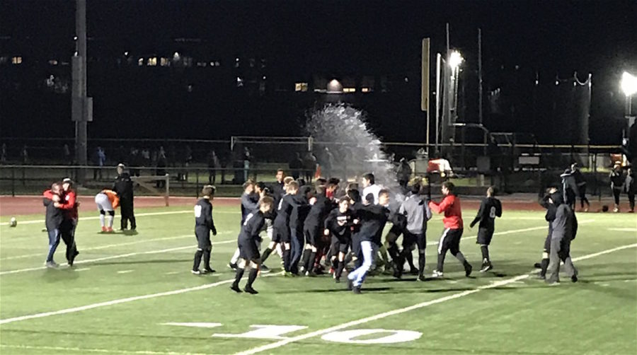 Watertown celebrates after defeating Wayland in penalty kicks in the Division 3 North boys' soccer semifinals Wednesday, Nov. 8, 2017, at Woburn High. After a scoreless draw, Watertown won on penalty kicks, 5-4, to advance to Sunday's sectional final.