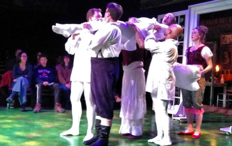 Cast members lift James Patrick Nelson during a dress rehearsal of Bedlam's