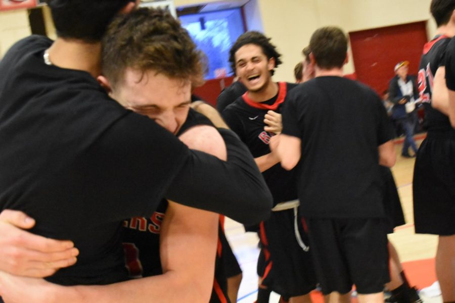 Watertown celebrates its 66-61 victory over Burke in the Division 3 Eastern Mass. championship game March 13, 2018, in Burlington.