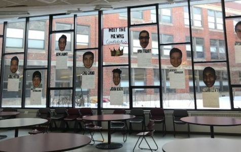 The oversized faces of the 10 competitors for the crown of Mr. WHS  are displayed in the Watertown High cafeteria. This year's contest is Tuesday, March 20, at 6 p.m.