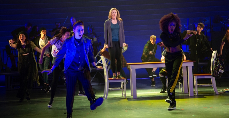 Elizabeth Stanley as Mary Jane Healy (center) and the chorus perform a song from Jagged Little Pill at American Repertory Theater.