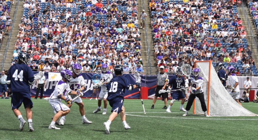 Yale's Jack Tigh (18) closes in on the Albany cage in the first game of the NCAA Division 1 semifinals Saturday, May 26, 2018, at Gillette Stadium.