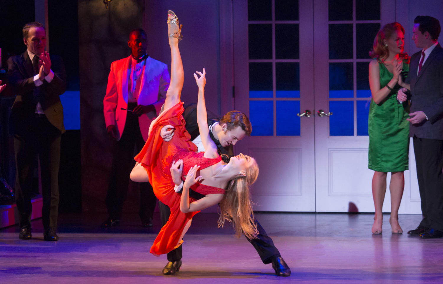 Anais Blake (as Penny Johnson, in red) and Aaron Patrick Craven (Johnny Castle) are in the spotlight in the national touring production of
