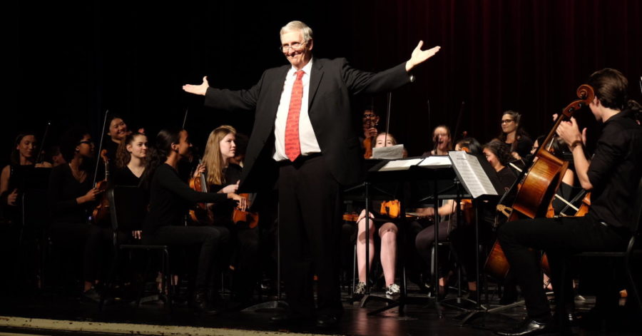 Dr. Frederik Schuetze, who is retiring at the end of the school year, takes a bow after leading his students in