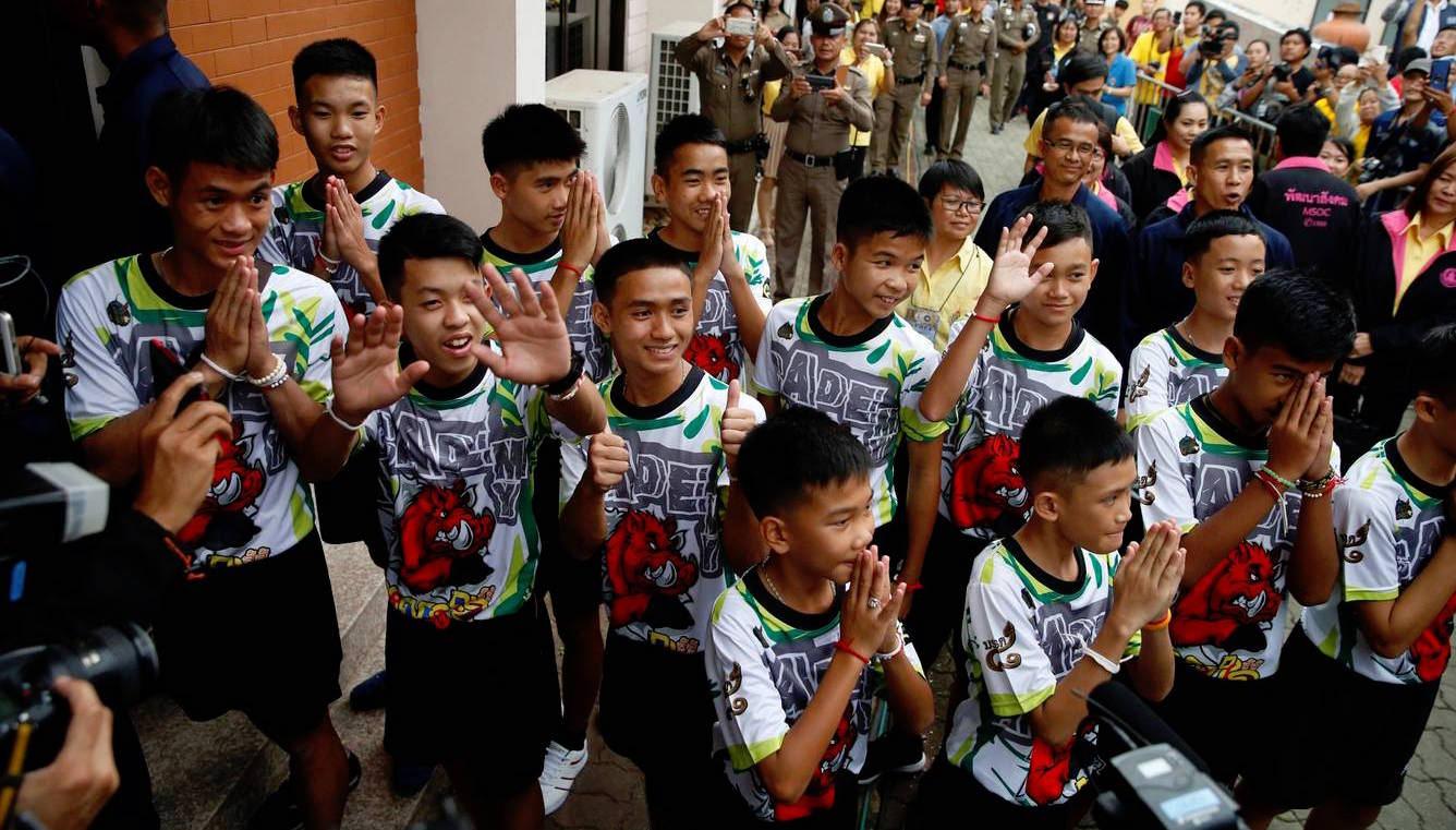 The 12 members of the Wild Boars soccer team and their coach arrive for a news conference in Chiang Rai, Thailand.