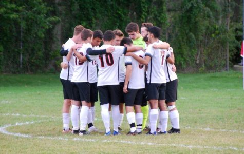 The Watertown boys' soccer team takes a moment before its 1-0 win at Melrose on Thursday, Sept. 20, 2018.