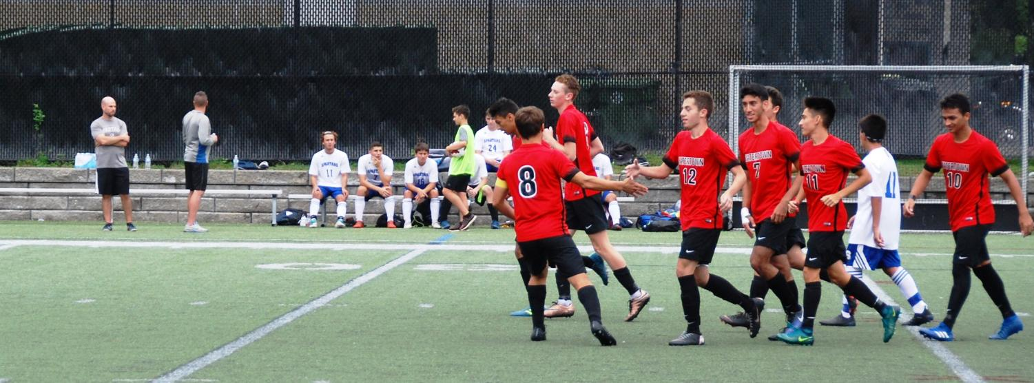 Watertown celebrates after Xhonatan Kadi's opening goal Saturday, Sept. 15, 2018, as the Raiders defeated Stonham, 4-1, at Victory Field.
