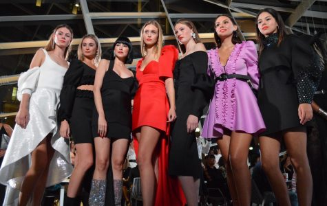 "Models pose on the runway at Boston Fashion Week's official opening night event, ""The Power of Women, The Future of Boston Fashion,"" on Sunday, Sept. 30."