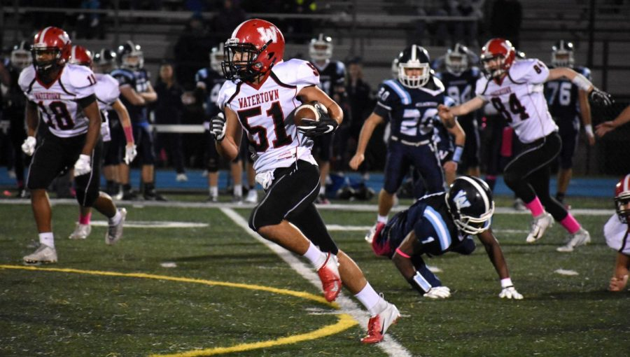 %28Picture+3+of+6+in+a+series%29+David+Manoukian+finds+daylight+during+his+72-yard+kickoff+return+for+a+touchdown+during+the+second+quarter+of+Watertown+High%27s+game+at+Wilmington+Oct.+5%2C+2018.+