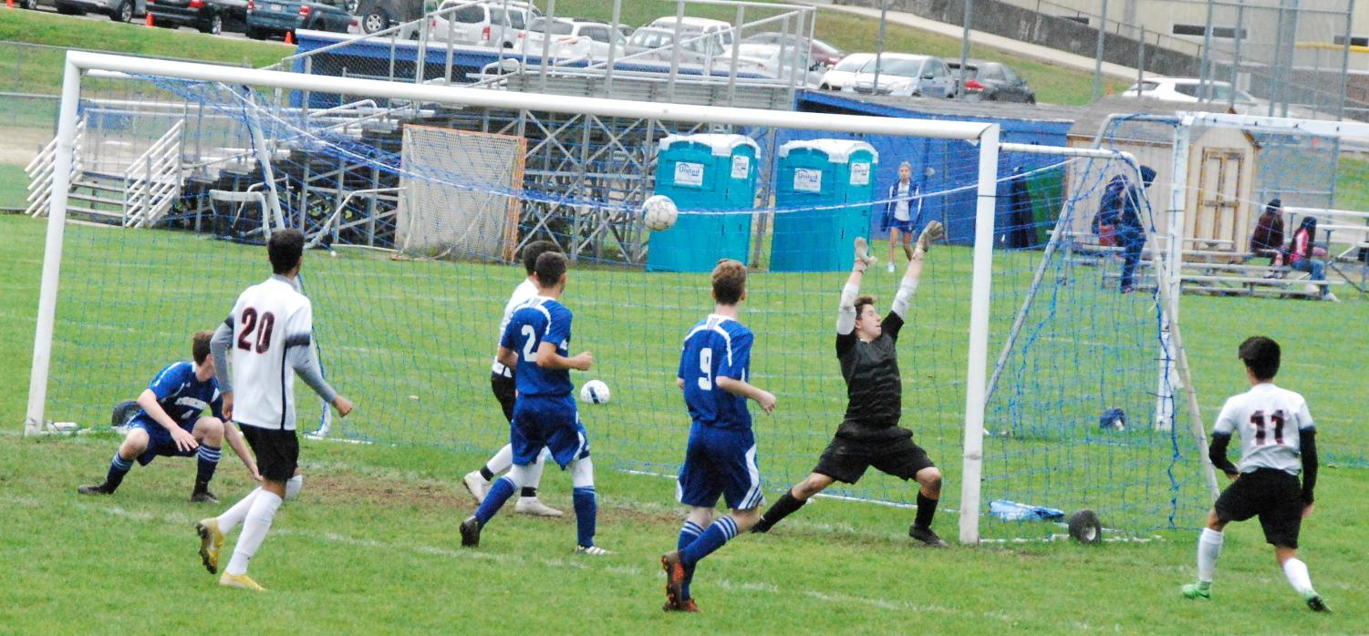 Watertown's Justin Viasus beats the Stoneham keeper as the Raiders boys' soccer team defeated Stoneham, 5-2, on Saturday, Oct. 20, 2018.