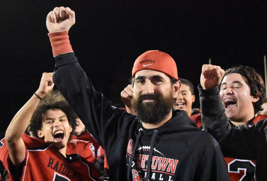 Watertown High football coach John Cacace celebrates with his team after the Raiders defeated Lynnfield, 7-2, on Oct. 26, 2018, at Victory Field.
