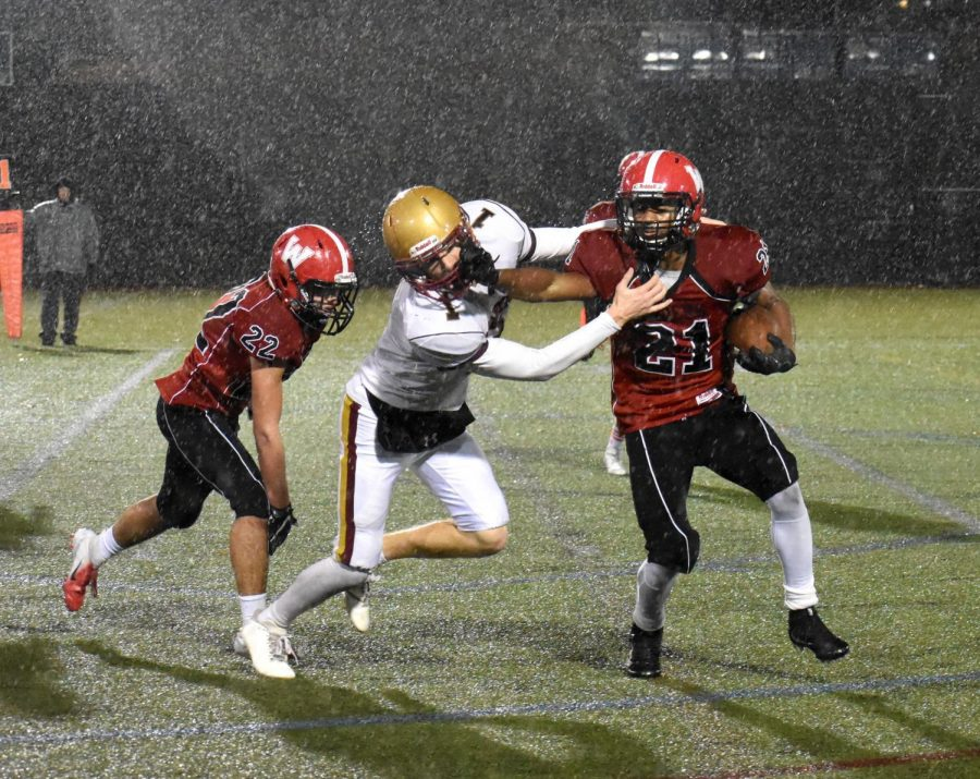 Watertown High School senior Mange Camara (21) scored three touchdowns in his last football game at Victory Field, a 25-22 win by the Raiders over Newburyport on Nov. 9, 2018.
