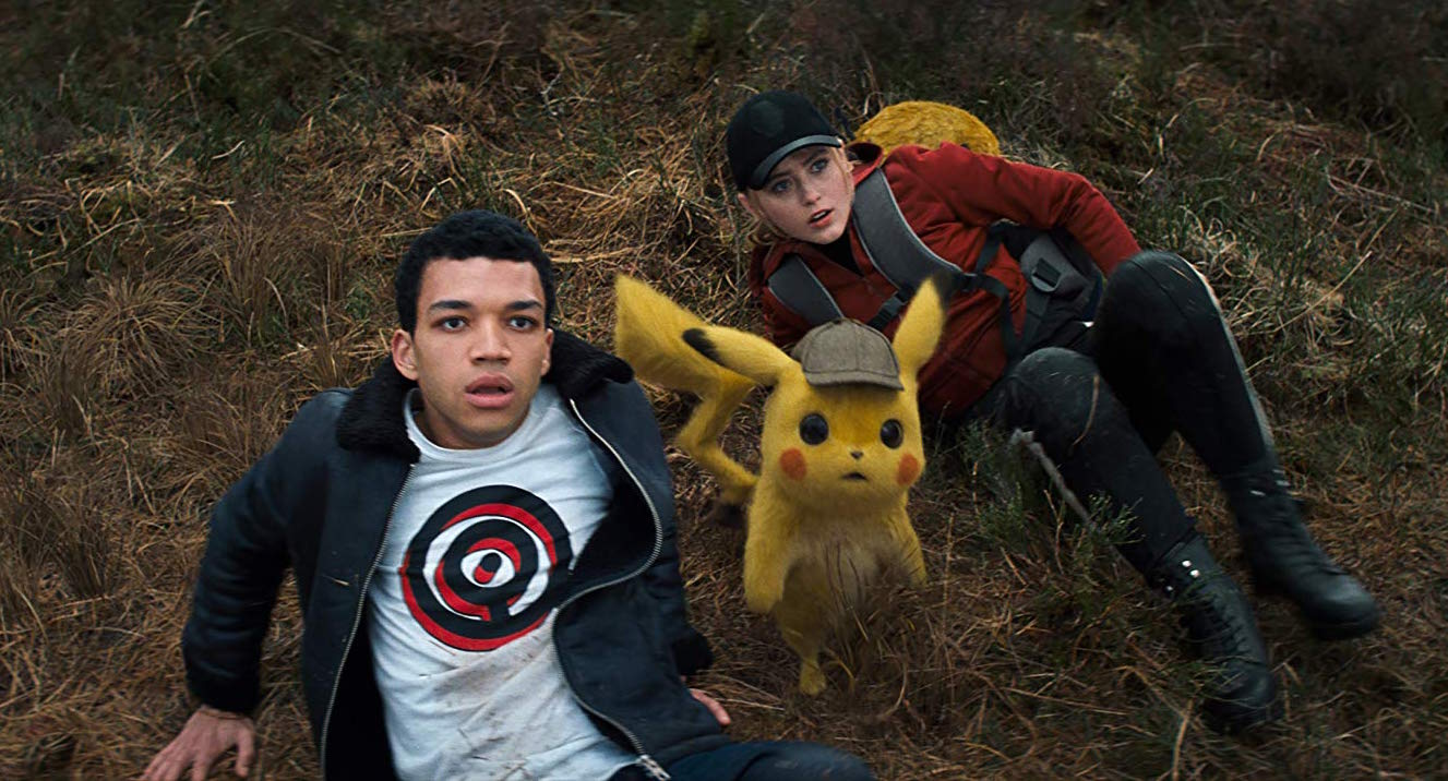 Ryan Reynolds is the voice of Detective Pikachu (center), alongside Justice Smith (left) and Kathryn Newton in 'Pokémon Detective Pikachu'.