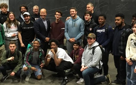 Presidential candidate John Delaney (standing, middle row, fourth from left) poses with students and teachers after a question-and-answer session at Watertown (Mass.) High School on May 3, 2019.