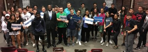 Presidential candidate Wayne Messam (in suit) poses with students and teachers after a question-and-answer session at Watertown (Mass.) High School on May 22, 2019.