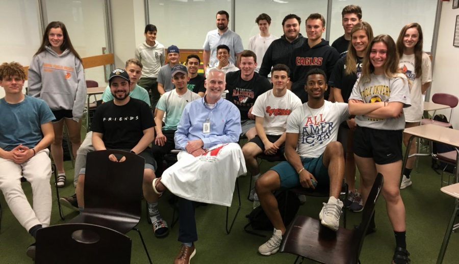 Jim McBride (front row, center), who covers the New England Patriots for the Boston Globe, poses with Graham Madden's Sports in Literature class at Watertown High School on May 20, 2019.