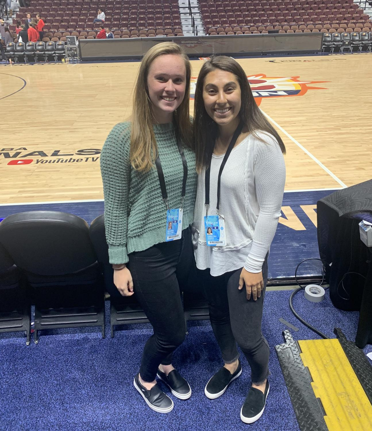 Raider Times reporters Brianna Williams (left) and Christina Zouein pose courtside after covering Game 3 of the WNBA Finals at Mohegan Sun Arena on Oct. 6, 2019.