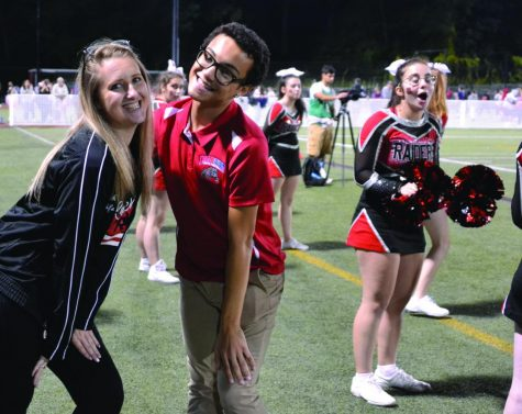 Marcus Moore (center) was a member of Watertown High's Class of 2019, but continues to help with the cheer squad.