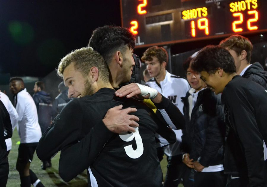 The Watertown High School boys' soccer team celebrates after defeating Dracut, 2-1, in double overtime in a MIAA Division 3 North quarterfinal game at Victory Field on Wednesday, Nov. 6, 2019.