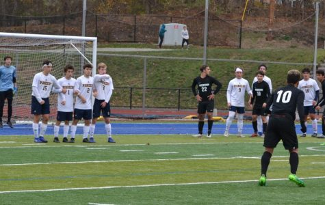 Lynnfield and goalie Dante Gesamondo (15 saves) prepare as Watertown's Arthur Metzker lines up a free kick in the 55th minute of the MIAA Division 3 North semifinals on Monday, Nov. 11, 2019, at St. John's Prep in Danvers.