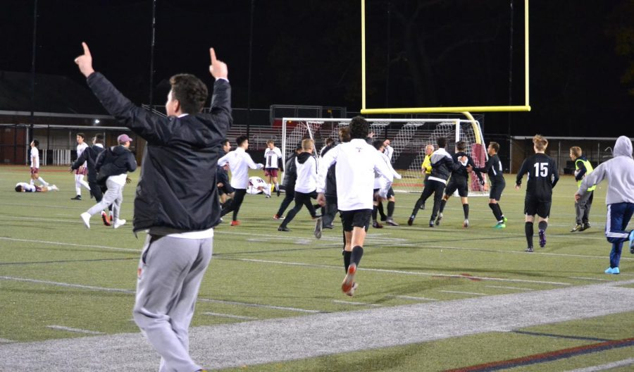 Watertown celebrates after Nicholas Dipace scored the game-winner in the 3-2 Raiders' MIAA Division 3 North tournament victory over Weston at Victory Field on Monday, Nov. 4, 2019.