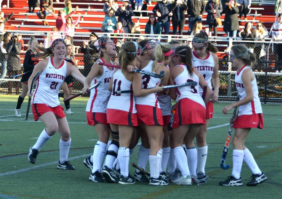 Watertown High School celebrates a goal by Elizabeth Loftus in overtime to win its MIAA Division 2 North field hockey tournament quarterfinal over Wayland, 1-0, on Saturday, Nov. 2, 2019, at Victory Field in Watertown.