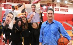 Watertown High boys' basketball coach Steve Harrington (right) poses with fans after he won the 400th game of his career, 56-45, when the Raiders beat Saugus in the first round of the MIAA Division 3 North tournament on Feb. 25, 2020, at Watertown High School.