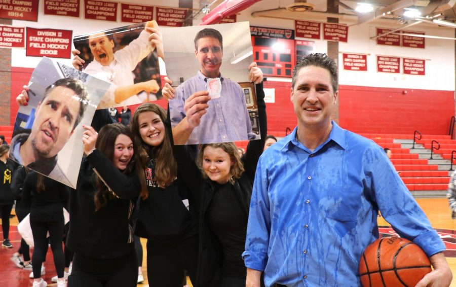 Watertown+High+boys%27+basketball+coach+Steve+Harrington+%28right%29+poses+with+fans+after+he+won+the+400th+game+of+his+career%2C+56-45%2C+when+the+Raiders+beat+Saugus+in+the+first+round+of+the+MIAA+Division+3+North+tournament+on+Feb.+25%2C+2020%2C+at+Watertown+High+School.