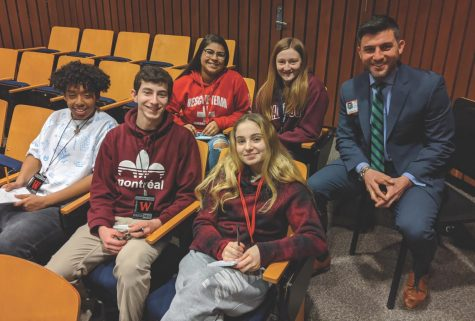 New Watertown High School principal Joel Giacobozzi (right) poses with Raider Times reporters in the lecture hall on Jan. 30, 2020, during his daylong interview sessions when he was still one of three finalists