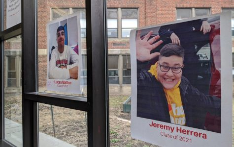 Photos of contestants in this year's edition of Mr. WHS line the windows of the Watertown High School cafeteria.