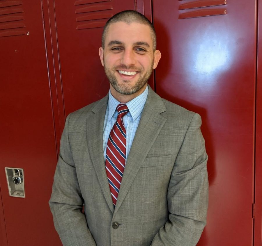 New principal Joel Giacobozzi stands in the hallway of Watertown High School on. Oct. 9, 2020.
