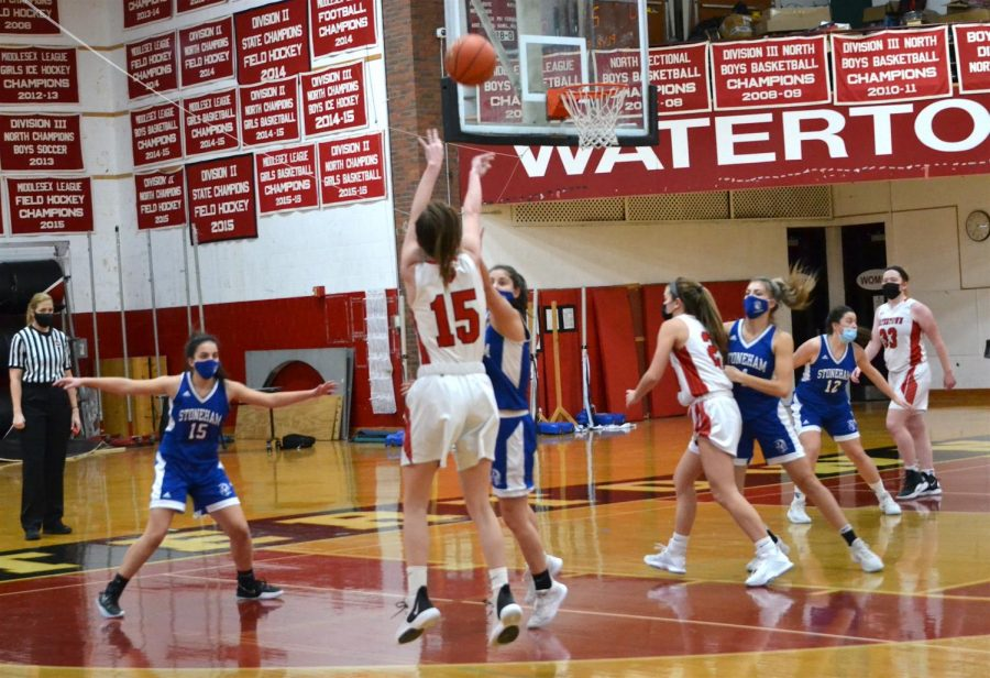 (1 of 2) Junior Ellie Monahan (15) lets fly a 3-pointer as the Watertown girls' basketball team remained undefeated with a 42-19 victory over visiting Stoneham on Saturday afternoon, Jan. 23, 2021.
