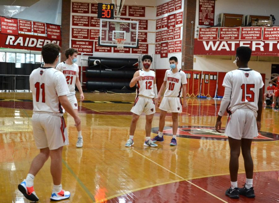 Joe Spinelli (11), Adam Patterson (21), Gabe Spinelli (12), Tyler Timperio (10), and Fred Labossiere (15) during the Raiders' 65-53 season-opening win against visiting Wakefield on Jan. 2, 2021.