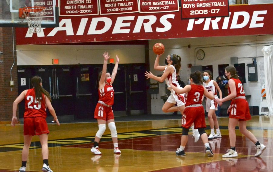 Ninth-grader Lily Lambo puts up a runner during the Watertown High girls' basketball team's 34-30 win over visiting Wakefield on Saturday morning, Jan. 9, 2021.