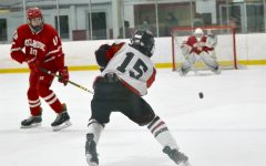 Sophomore Daniel Tattrie lets fly during the Watertown High boys' hockey team's 4-1 loss to visiting Melrose on Jan. 13, 2021, at John A. Ryan Arena.
