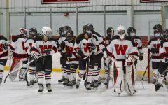 The Watertown High girls' hockey team prepares to play Belmont on Monday, Jan. 18, 2021, at John A. Ryan Arena.