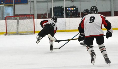 Sophomore Anthony Venezia (2) seals Watertown