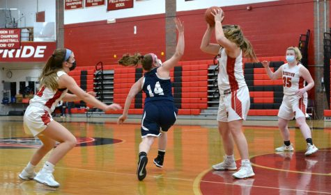 Junior Taylor Lambo (center) and her freshman sister Lily Lambo (left) play keepaway during the Watertown girls