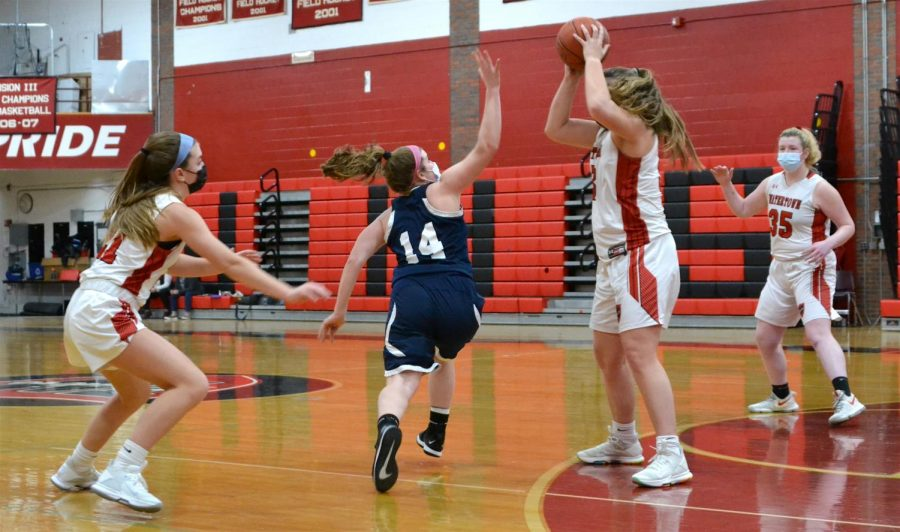 Junior Taylor Lambo (center) and her freshman sister Lily Lambo (left) play keepaway during the Watertown girls' basketball team's 40-29 win over visiting Wilmington on Feb. 10, 2021.