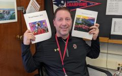 Malcolm Cooke, adviser for the Word Painter art and literary magazine at Watertown High School, poses with some past copies in his office.