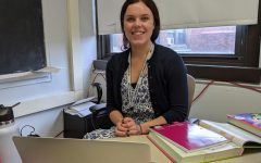 New math teacher Sarah Mepham poses at her desk during her first week at Watertown High School.
